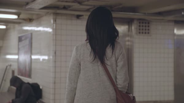 Tracking shot of a woman walking in a subway passage in New York Royalty-free stock video
