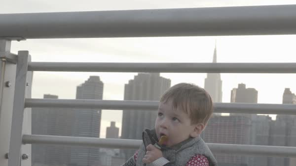 Slow motion shot of a boy using a pacifier by East River Royalty-free stock video