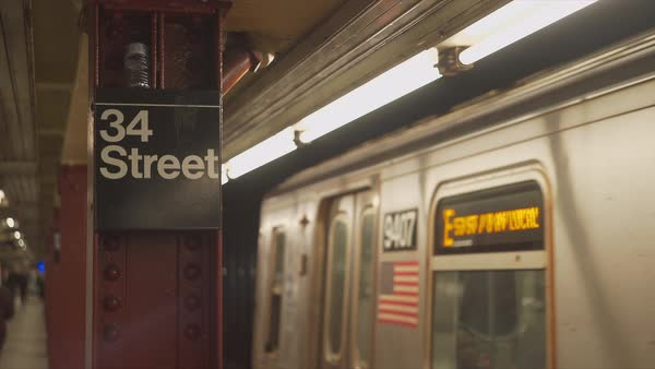 Steadicam shot of a train passing through a subway station Royalty-free stock video
