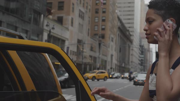 Steadicam shot of a woman talking on a phone while taking a taxi Royalty-free stock video