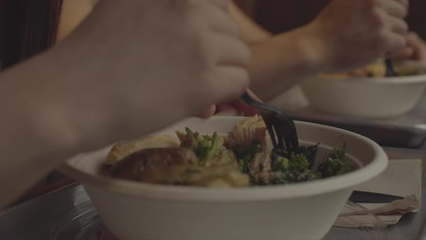 Hand-held shot of a man and a woman eating together Royalty-free stock video
