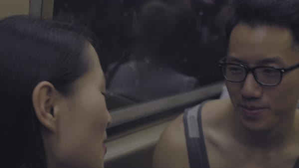 Hand-held shot of a young couple sitting in a subway train Royalty-free stock video