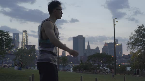 Young man doing a workout in NYC park Royalty-free stock video