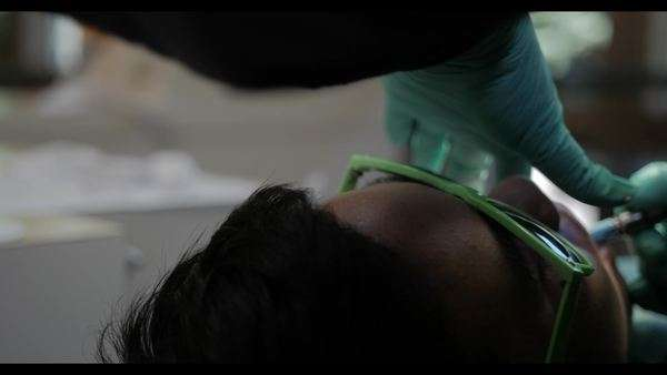 Cinematic sliding shot of patient getting work done. Royalty-free stock video