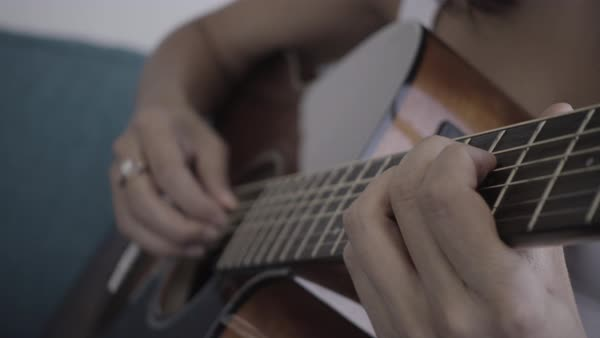 Close-up shot of a woman playing the guitar Royalty-free stock video