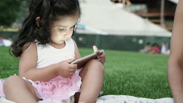 Hand-held shot of a toddler watching a cell phone screen Royalty-free stock video