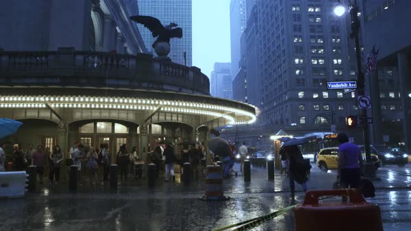 Wide shot of pedestrians on a rainy day in New York City, USA Royalty-free stock video