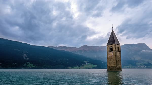 Timelapse of bell tower of a submerged church in Lake Resia Royalty-free stock video