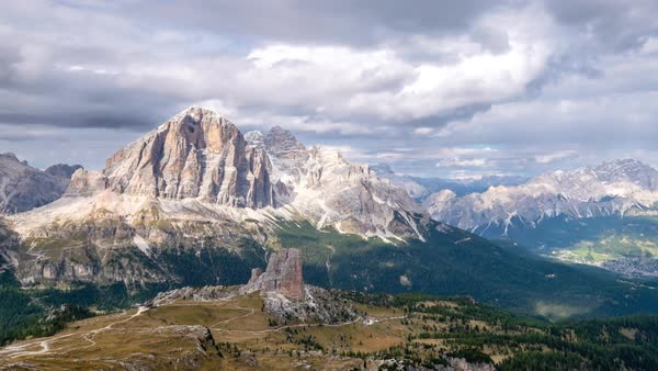 Timelapse of clouds moving over snow covered Dolomites mountains Royalty-free stock video