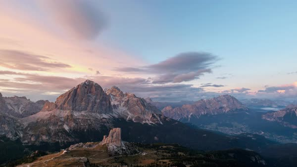 Timelapse of clouds moving over snow covered Dolomites mountains at sunset Royalty-free stock video