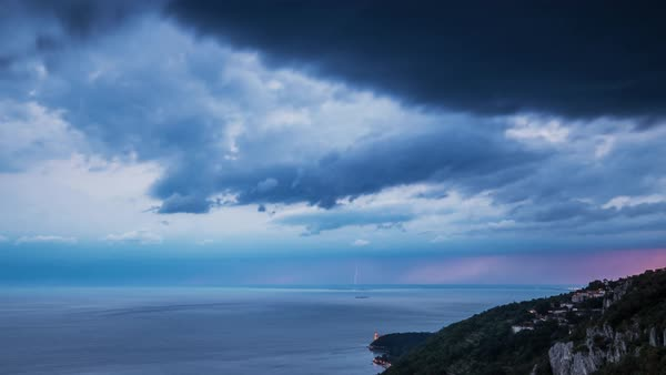 Timelapse of lightning and clouds moving over sea at Trieste, Italy at dusk Royalty-free stock video