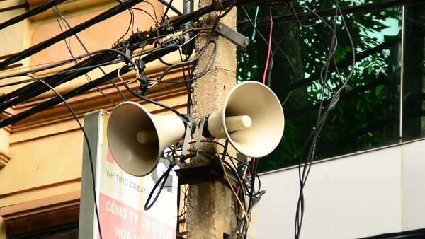 Zoom Out of Propaganda Loudspeaker on Telephone Pole - Ho Chi Minh City Royalty-free stock video