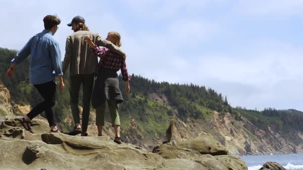 Friends Hug And Raise Their Arms In Celebration, Hold Up Peace Signs, Enjoying The Beauty Of The Oregon Coast, USA Royalty-free stock video