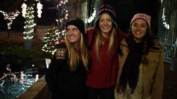 Three Teens Walking In A Winter Wonderland Of Holiday Lights – Slow Mo Royalty-free stock video