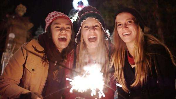 Close Up Portrait of 3 Teen Girls Celebrating Winter Holidays W/Sparklers-Slow Mo Royalty-free stock video
