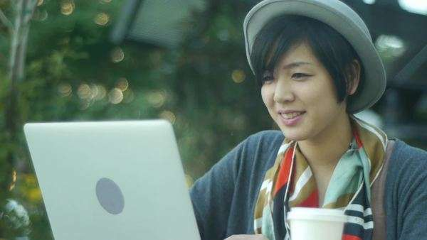 Close Up of a Young Asian Woman With Her Laptop At A Cafe Counter Royalty-free stock video