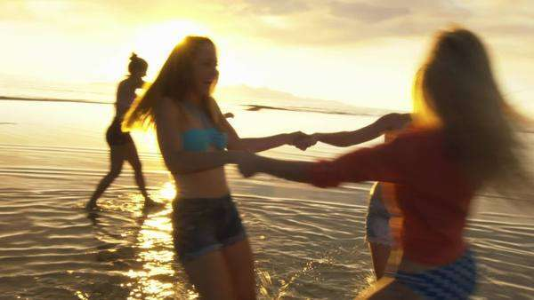 Group of Five Teenage Girls Dancing In The Water At The Beach At Sunset Royalty-free stock video