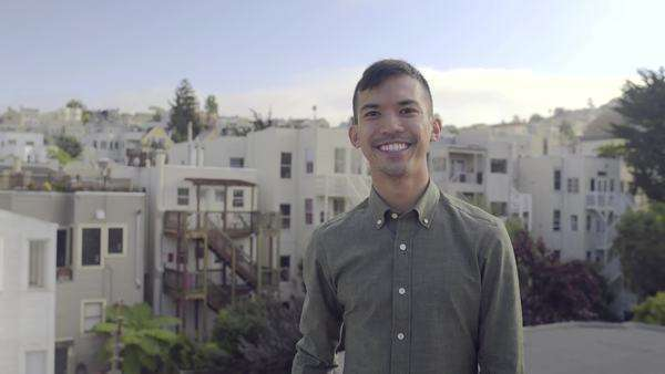 Man smiles for a portrait on a rooftop in San Francisco Royalty-free stock video