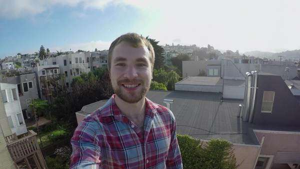Happy tourist takes a selfie on a rooftop in San Francisco Royalty-free stock video