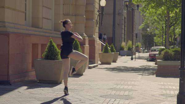 Beautiful ballerina practices her spins and technique in city square Royalty-free stock video