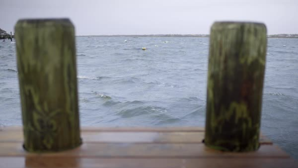 View from end of a dock looking out at stormy sea Royalty-free stock video
