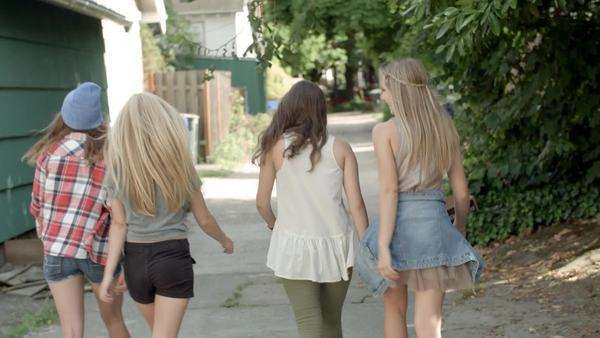 4 friends have fun skipping, giving piggyback rides, holding hands in alley Royalty-free stock video