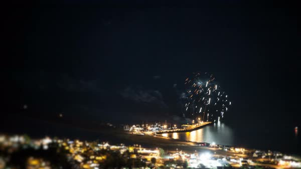 Far and High View of Fireworks Timelapse on the Shore of the Ocean. Royalty-free stock video