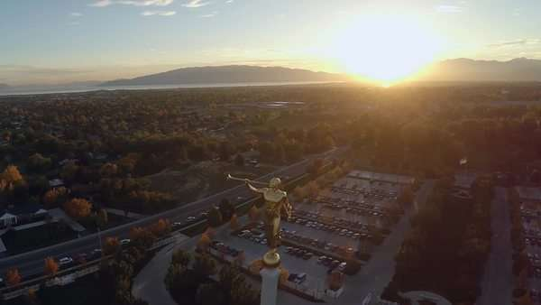 Mormon Temple Mount Timpanogos Aerial view at sunset showing mountains and lake in the background Royalty-free stock video