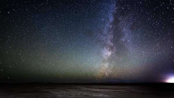 Amazing Milky way timelapse in Great Salt Lake Flats in Utah with satellites that zoom by... Royalty-free stock video
