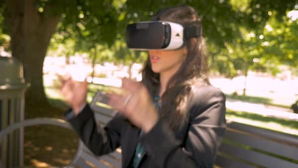 Businesswoman removing her VR headset leaving augmented virtual reality and disappointed to enter the real world outside in slow motion push in Royalty-free stock video