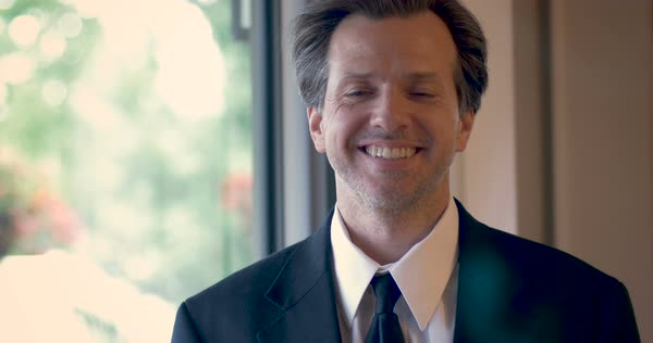 Handsome professional man in a suit smiling, nodding and laughing Royalty-free stock video