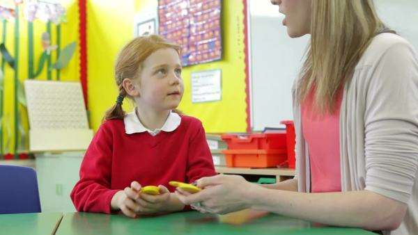 Teacher with girl sitting at playing number games. Royalty-free stock video