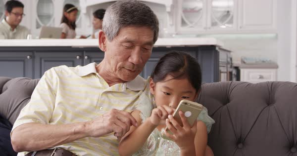 Grandfather and granddaughter using mobile phone Royalty-free stock video