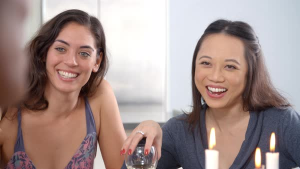 Young women in conversation at a dinner table, slow motion Royalty-free stock video
