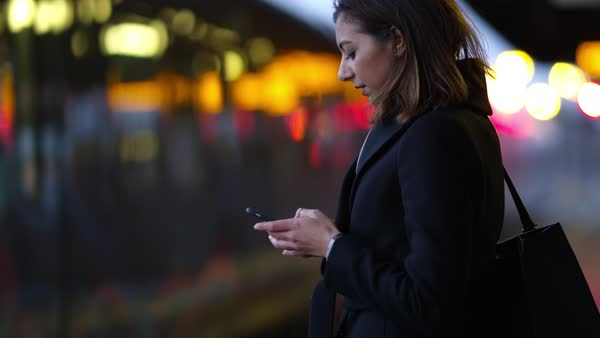 Businesswoman on platform waiting for train Royalty-free stock video