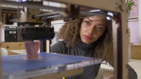 Female designer working with 3d printer in a design studio Royalty-free stock video