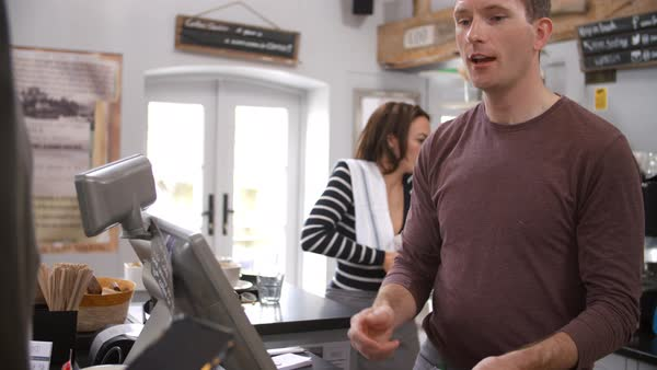 Customer making contactless payment with phone over counter Royalty-free stock video