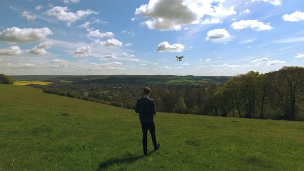 Aerial shot of man flying drone over countryside Royalty-free stock video