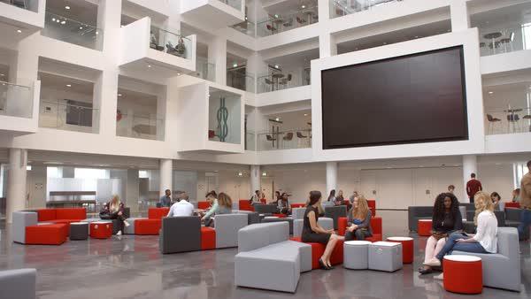Study rooms overlooking atrium in modern university building - Stock ...