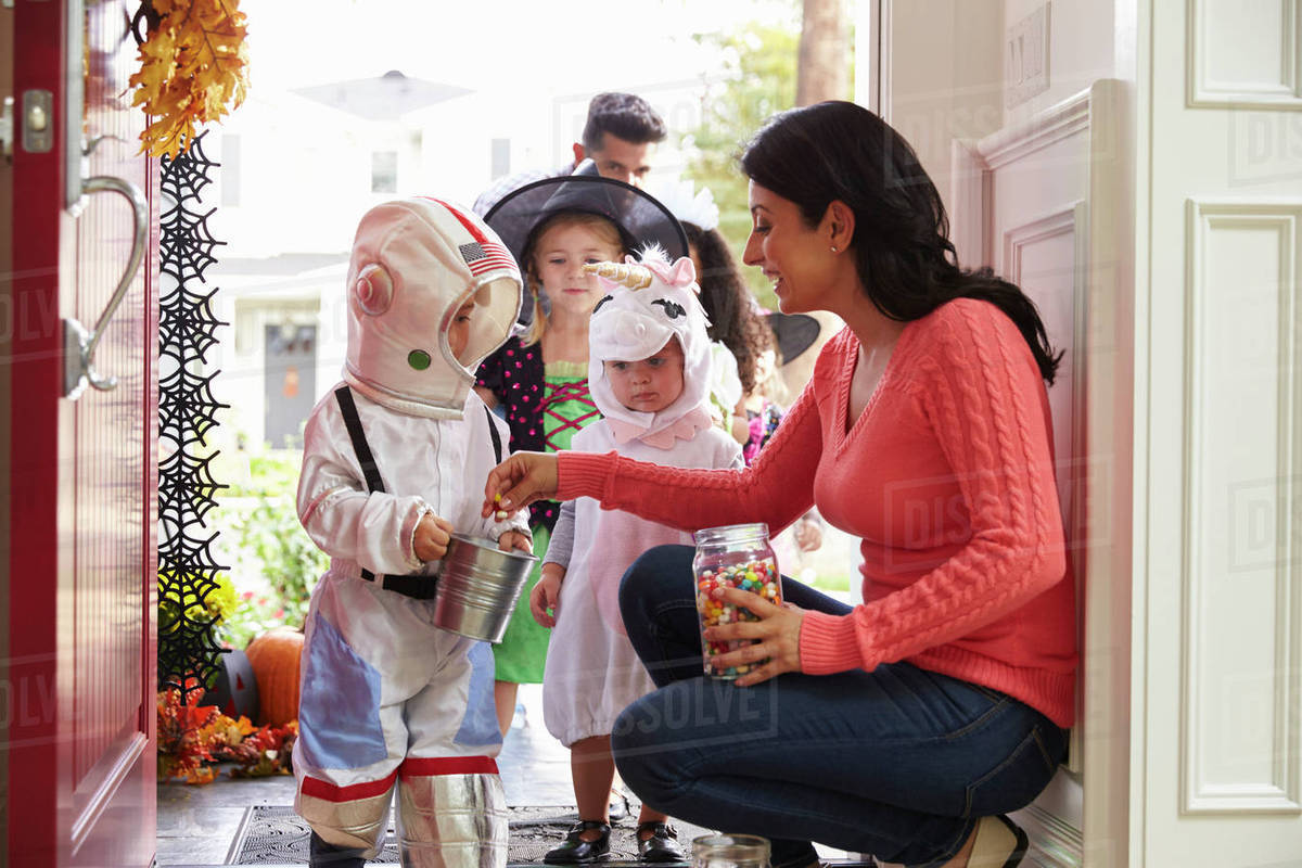 Children In Halloween Costumes Trick Or Treating Royalty-free stock photo