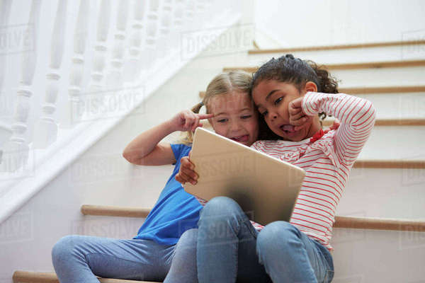 Two Girls Posing For Selfie On Digital Tablet At Home Royalty-free stock photo