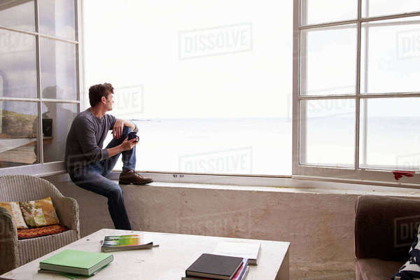 Man Sitting At Window And Looking At Beautiful Beach View Royalty-free stock photo