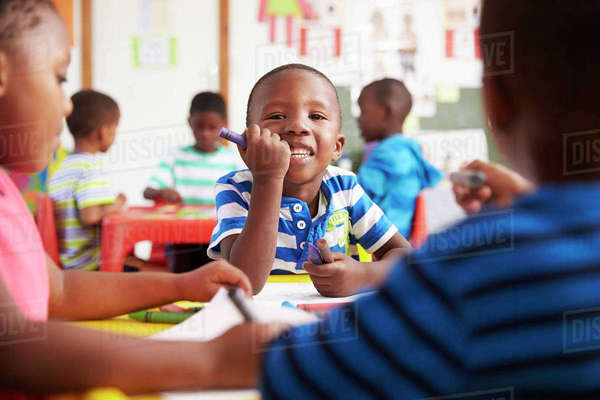 Preschool class in South Africa, boy looking to camera Royalty-free stock photo