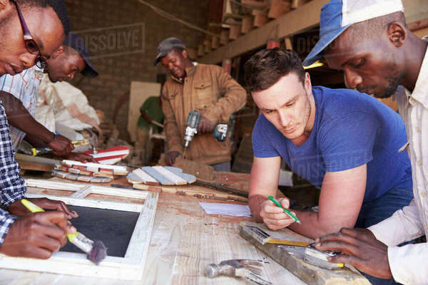 Men at work in a carpentry workshop, South Africa, close-up Royalty-free stock photo