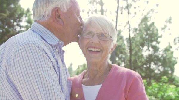Slow motion of loving senior couple embracing in garden. Royalty-free stock video