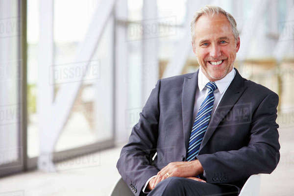 Portrait of smiling senior corporate businessman, waist up Royalty-free stock photo