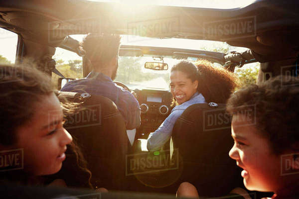 Happy family on a road trip in their car, rear passenger POV Royalty-free stock photo