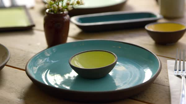 Handmade earthenware on restaurant table, camera slider shot Royalty-free stock video