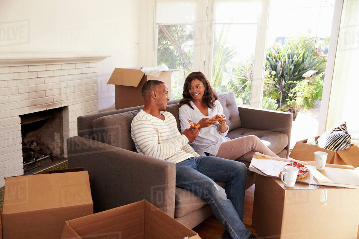 Take A Break On Sofa With Pizza Moving Day