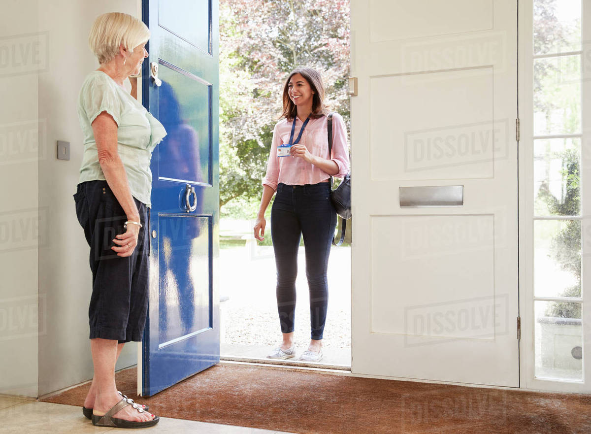 Senior woman opens door to female care worker on home visit  sc 1 st  Dissolve & Senior woman opens door to female care worker on home visit - Stock ...